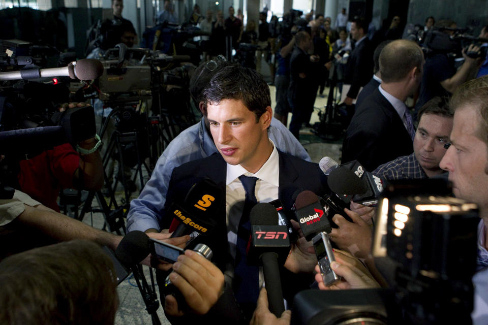 Pittsburgh Penguins' Sidney Crosby speaks with reporters following collective bargaining talks, Tuesday, Aug. 14, 2012, in Toronto. (AP Photo/The Canadian Press, Chris Young)