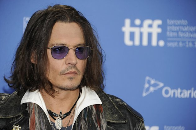 "FILE - In this Sept. 8, 2012 file photo, actor Johnny Depp participates in a photo call and press conference for the film ""West of Memphis"" at TIFF Bell Lightbox during the Toronto International Film Festival, in Toronto. HarperCollins Publishers announced Monday, Oct. 15, 2012, that Depp will help run an imprint that will be a home for ""authentic, outspoken and visionary"" books. (Photo by Evan Agostini/Invision/AP, File)"