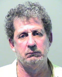 This booking photo released by the Detroit Police Department shows Ronald Ilitch. Authorities in Detroit say that Ilitch, a son of Detroit Tigers and Red Wings owner Mike Ilitch, was caught with cocaine after a traffic stop. Fifty-seven-year-old Ronald Ilitch was released from jail Thursday, Aug. 28, 2014, after being arraigned on a charge of possessing less than 25 grams of a controlled substance. (AP Photo/Detroit Police Department)
