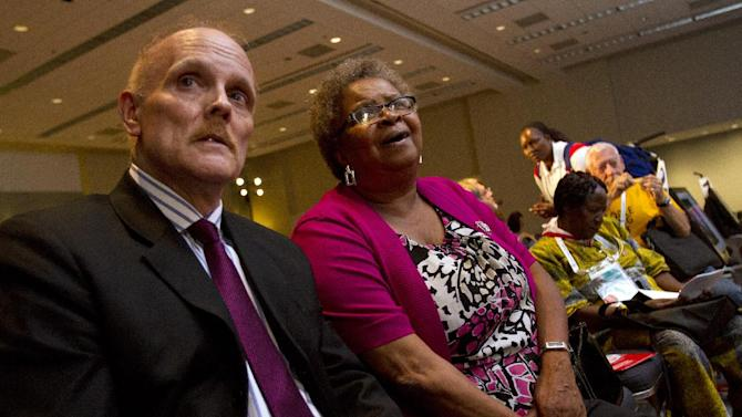 """In this photo taken July 25, 2012, Stephen Karpiak, with the AIDS Community Research Initiative of America, left, and Carolyn Massey, 54, of Laurel, Md., who has HIV, wait for the start of a panel, """"Aging With HIV,"""" that they are speaking on at the International AIDS Conference in Washington. AIDS is graying: By the end of the decade, the government estimates, more than half of Americans living with HIV will be over 50. Even in developing countries, more people with the AIDS virus are surviving to middle age and beyond.  (AP Photo/Jacquelyn Martin)"""