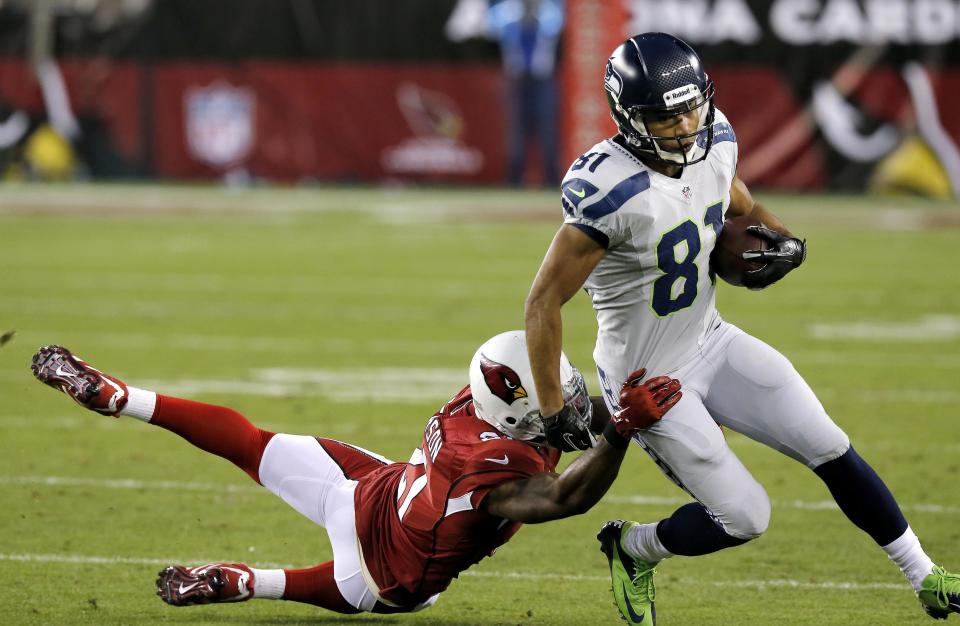 Arizona Cardinals cornerback Patrick Peterson (21) tackles Seattle Seahawks wide receiver Golden Tate (81) during the first half of an NFL football game, Thursday, Oct. 17, 2013, in Glendale, Ariz. (AP Photo/Ross D. Franklin)