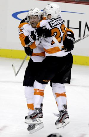Philadelphia Flyers right wing Jakub Voracek (93) celebrates with center Claude Giroux (28) after scoring the winning goal late in the third period of an NHL hockey game against the Pittsburgh Penguins in Pittsburgh, Wednesday, Feb. 20, 2013. The Flyers won 6-5. (AP Photo/Gene J. Puskar)