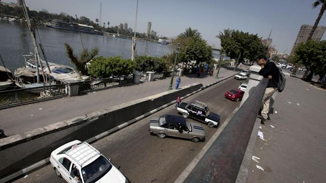 Egyptian motorists turn back with their vehicles after protesters closed the main street by the Nile river in downtown Cairo, Egypt, Sunday, March 10, 2013. Hundreds of police officers went on strike in recent days but Egypt's embattled interior minister, Mohammed Ibrahim, said on Sunday that he will not allow vigilante groups to fill in for his force, which has been strained by daily protests, violent clashes and harsh criticism from the media. (AP Photo/Nasser Nasser)