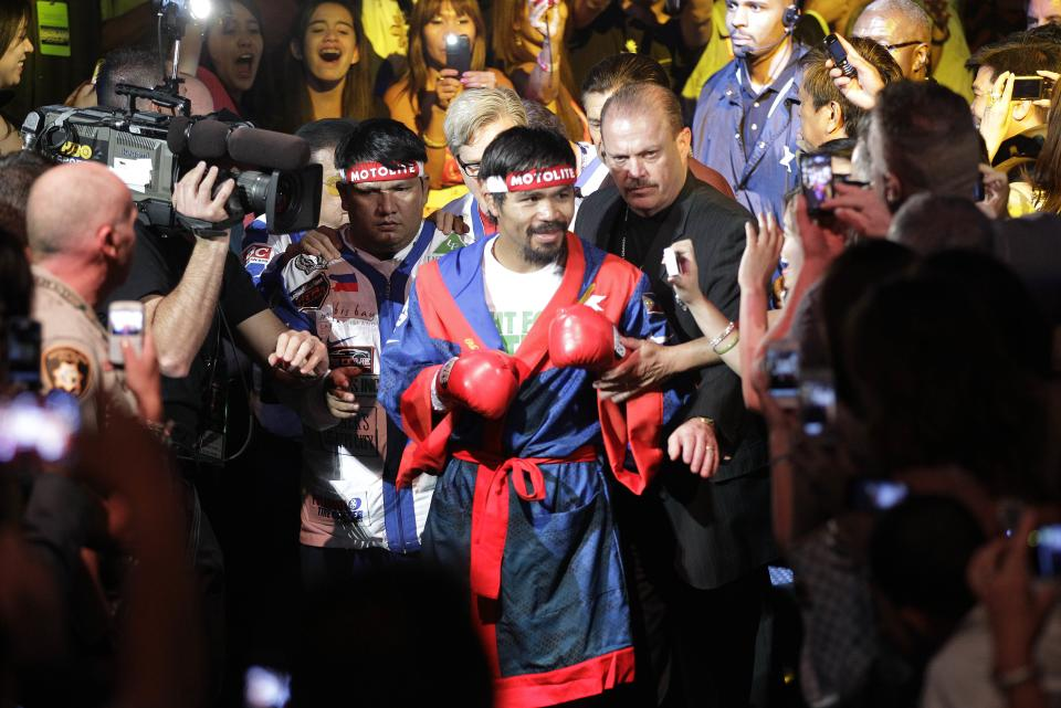 Manny Pacquiao, from the Philippines, arrives for his WBO welterweight title fight against Timothy Bradley, from Palm Springs, Calif., Saturday, June 9, 2012, in Las Vegas. (AP Photo/Julie Jacobson)
