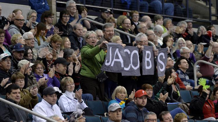Fans of the Jacobs rink celebrate after he defeated the Morris rink at the Roar of the Rings Canadian Olympic Curling Trials in Winnipeg