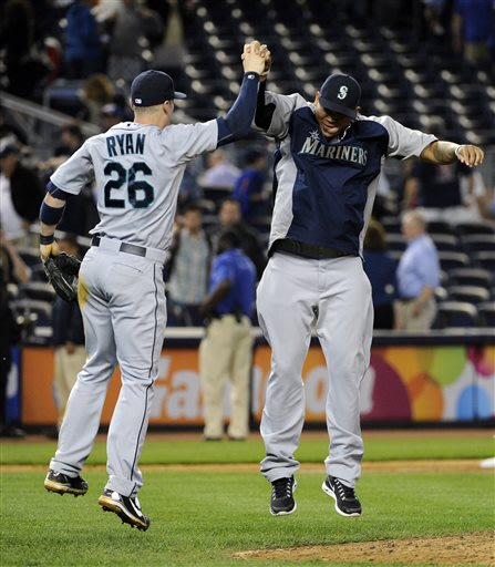Seattle Mariners' Brendan Ryan, left, celebrates with Felix Hernandez after defeating the New York Yankees, 3-2, in a baseball game on Thursday, May 16, 2013, at Yankee Stadium in New York