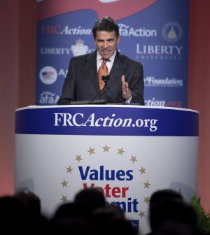 Republican presidential hopeful Gov. Rick Perry of Texas gestures during a speech at the Values Voter Summit on Friday, Oct. 7, 2011, in Washington.  (AP Photo/Evan Vucci)