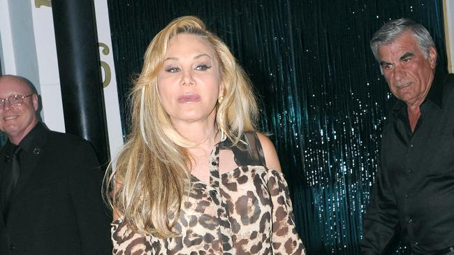 Adrienne Maloof seen leaving after dinner at Mastros Steakhouse, wearing a leopard print top with a deep back cut, exposing her inner wear in Beverly Hills