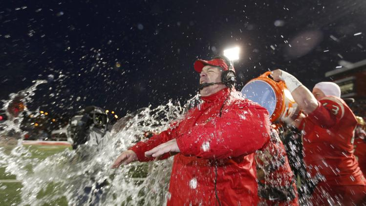 Laval Rouge et Or head coach Glen Constantin has water dumped on his head by Pierre Lavertu as they defeat the Calgary Dinos to win the Vanier Cup University Championship football game in Quebec City