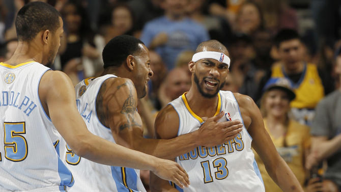 From left, Denver Nuggets forward Anthony Randolph joins guard Andre Iguodala in congratulating forward Corey Brewer after he made a basket and drew a shooting foul against the Los Angeles Lakers in the first quarter of an NBA basketball game in Denver on Monday, Feb. 25, 2013. (AP Photo/David Zalubowski)