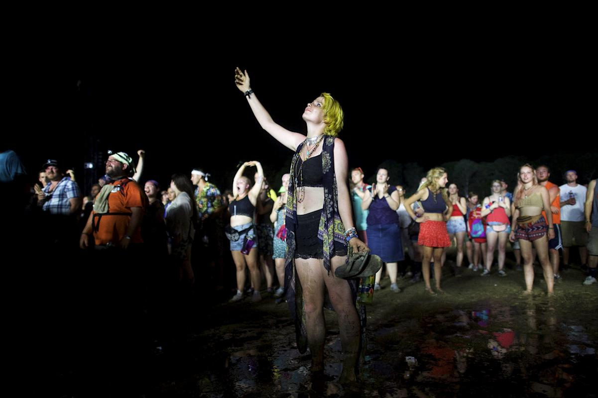 A woman points towards the sky during the performance by McCartney at the Firefly Music Festival in Dover