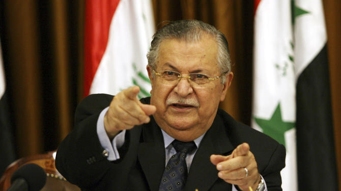FILE - In this Aug 17, 2007 file photo, Iraq's President Jalal Talabani talks to reporters in Baghdad, Iraq. The office of Iraqi President Jalal Talabani said Tuesday he has been admitted to the hospital for treatment of an unspecified health problem.. (AP Photo/Hadi Mizban, File)