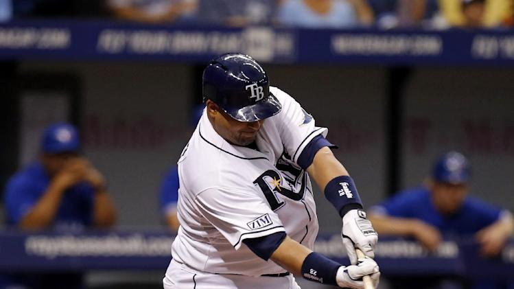 Tampa Bay Rays' Jose Molina connects on an RBI single during the fourth inning of a baseball game against the Toronto Blue Jays Saturday, July 12, 2014, in St. Petersburg, Fla. (AP Photo/Mike Carlson)