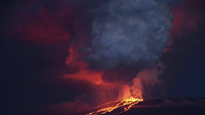 The Wolf volcano spews smoke and lava on Isabela Island, in this May 25, 2015 handout photograph provided by the Galapagos National Park
