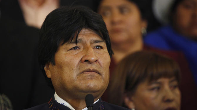 """Bolivia's President Evo Morales pauses during a news conference at the government palace in La Paz, Bolivia, Tuesday, March 5, 2013. Morales decreed seven days of mourning after Venezuela's vice president announced that Venezuela's President Hugo Chavez died on Tuesday. A teary-eyed Morales, one of Chavez's closest allies and most loyal disciples, declared that """"Chavez is more alive than ever."""" (AP Photo/Juan Karita)"""