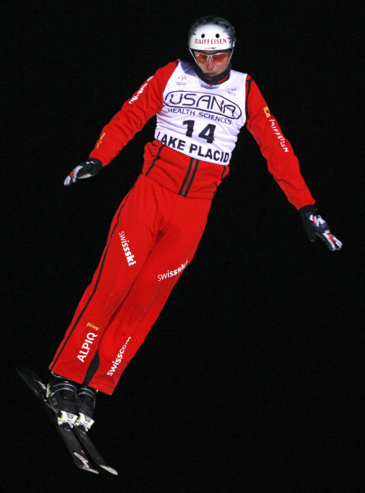 Thomas Lambert of Switzerland competes in the men's aerials World Cup freestyle skiing event in Lake Placid, N.Y., on Saturday, Jan. 21, 2012. Lambert won the event. (AP Photo/Mike Groll)