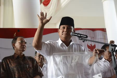 Indonesian presidential candidate Prabowo Subianto delivers a statement to the media in Jakarta