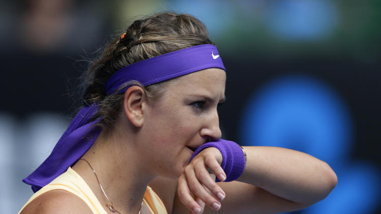 Victoria Azarenka of Belarus wipes the sweat from her face during her third round match against Jamie Hampton of the US at the Australian Open tennis championship in Melbourne, Australia, Saturday, Jan. 19, 2013. (AP Photo/Andy Wong)