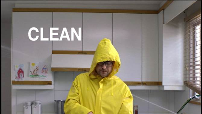An image made from a video provided by the USDA shows a scene from a new U.S. government campaign to raise awareness of safe handling of foods.  The campaign reminds people to clean  off surfaces and utensils, separate raw meats from other foods and other safety precautions.  (AP Photo/USDA)