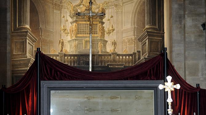 The Holy Shroud is seen during a Mass in the Cathedral of Turin