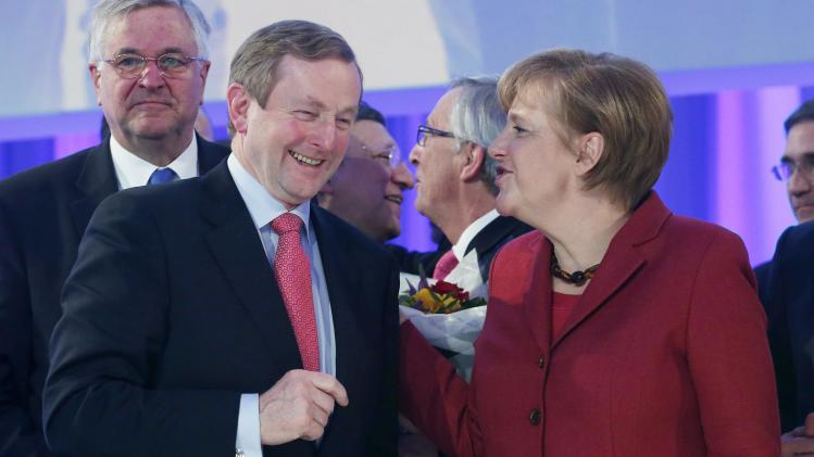 Ireland's PM Kenny and German Chancellor Merkel talk after the closing of the European People's Party Elections Congress in Dublin