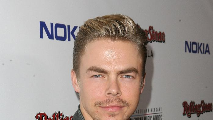 Derek Hough arrives at the Rolling Stone American Music Awards After Party, on Sunday, Nov. 18, 2012 in Los Angeles. (Photo by Casey Rodgers/Invision for Nokia/AP Images) **Please include any additional event details in the second sentence of the caption.