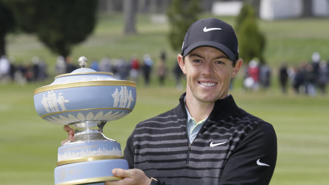 Rory McIlroy, of Northern Ireland, poses with his trophy on the 16th green of TPC Harding Park after winning the Match Play Championship golf tournament Sunday, May 3, 2015, in San Francisco. (AP Photo/Eric Risberg)