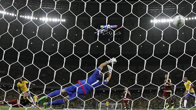 Willian of Brazil scores his second goal against goalkeeper Alain Baroja of Venezuela during their 2018 World Cup qualifying soccer match in Fortaleza, Brazil