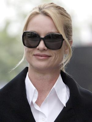 "Nicollette Sheridan arrives at court Thursday, March 15, 2012, in Los Angeles. A jury will enter their second day of deliberations into Sheridan's claims that she was wrongfully terminated from the show during its fifth series. Her attorneys contend her forced departure from the show was retaliation for her complaining that ""Desperate Housewives"" creator Marc Cherry hit her during an on-set dispute, but the veteran TV writer's attorney contends it was simply business. (AP Photo/Nick Ut)"