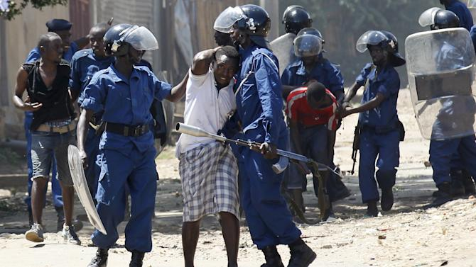 Riot policemen detain residents participating in street protests during clashes in Burundi's capital Bujumbura