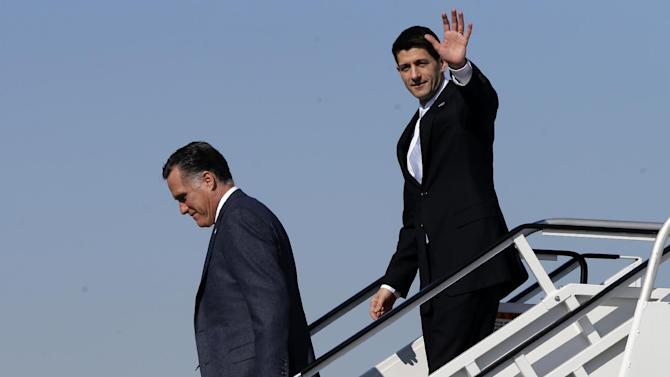 Republican presidential candidate, former Massachusetts Gov. Mitt Romney, followed by his vice presidential running mate, Rep. Paul Ryan, R-Wis., walk off Romney's plane in Cleveland, Ohio, Tuesday, Nov. 6, 2012. Ryan arrived moments earlier on his own plane and met Romney on board. (AP Photo/Charles Dharapak)