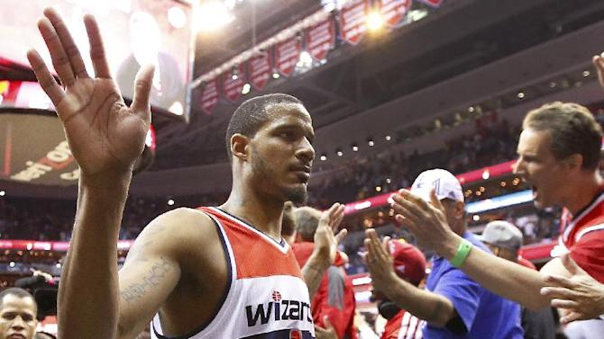 Washington Wizards forward Trevor Ariza (1) walks off the court after Game 4 of an opening-round NBA basketball playoff series against the Chicago Bulls in Washington, Sunday, April 27, 2014. The Wizards defeated the Bulls 98-89