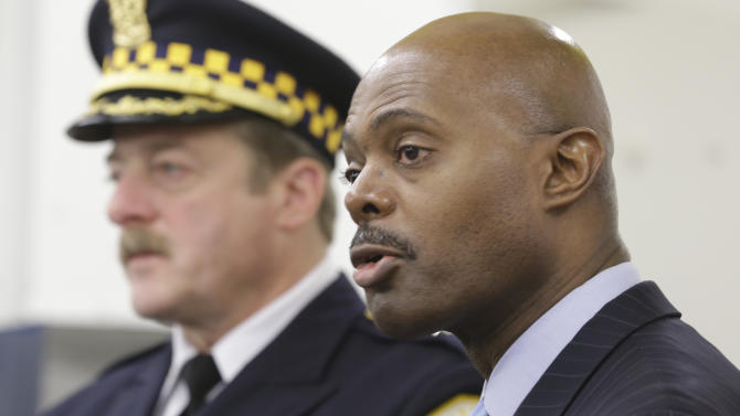 Chicago Police First Deputy Superintendent Alfonsa Wysinger, right, accompanied by Deputy Chief Wayne Gulliford speaks at a news conference Monday, Jan. 28, 2013, in Chicago. The pair joined other officers, elected officials, clergy, and community members, with a display of recently recovered firearms from the 574 seized to date beginning Jan. 1, 2013. (AP Photo/M. Spencer Green)