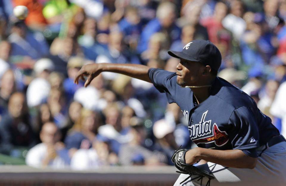 Atlanta Braves starter Julio Teheran throws against the Chicago Cubs during the first inning of a baseball game, Sunday, Sept. 22, 2013, in Chicago. (AP Photo/Nam Y. Huh)
