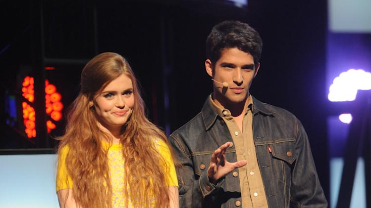 From left, Holland Roden and Tyler Posey present the fall lineup at the 2013 MTV Upfront, on Thursday, April 25, 2013 at the Beacon Theater in New York. (Photo by Brad Barket/Invision/AP Images)