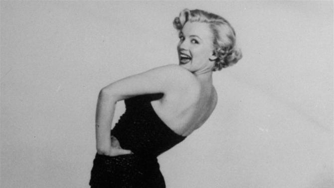 FILE - In this undated file photo, actress Marilyn Monroe is pictured mimicking Betty Grable's famous World War II pin-up pose. (AP Photo, File)