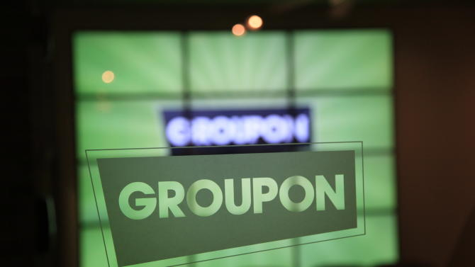 FILE - In this Sept. 22, 2011 file photo, the Groupon logo etched in glass is shown in the lobby of the online coupon company's Chicago offices. Groupon Inc., said Monday, Aug. 13, 2012, that its second-quarter earnings beat Wall Street's profit estimates, but it underwhelmed analysts with sales growth hurt by unfavorable currency movements. (AP Photo/Charles Rex Arbogast, File)