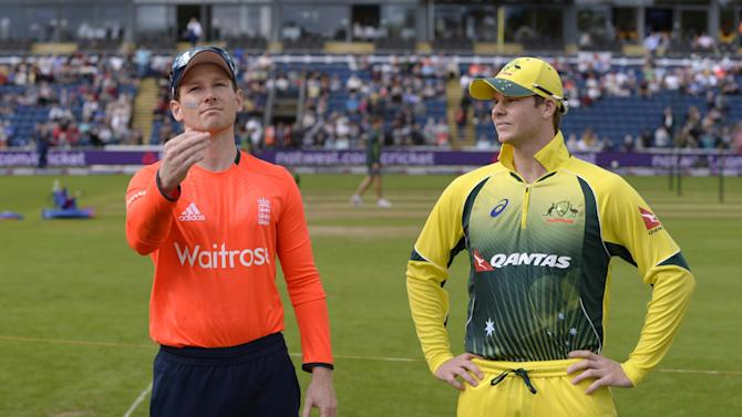 England's Eoin Morgan tosses the coin watched by Australia's Steve Smith
