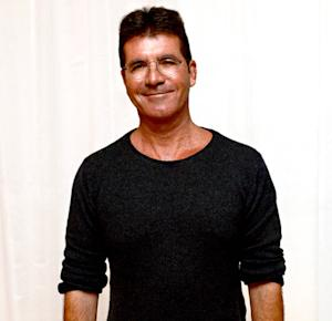 "Simon Cowell Feels ""Very Paternal,"" But Is ""Absolutely"" Not Changing Diapers"