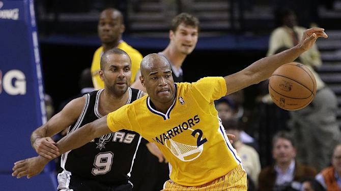 San Antonio Spurs' Tony Parker (9) and Golden State Warriors' Jarrett Jack, right, eye a loose ball during the second half of an NBA basketball game Friday, Feb. 22, 2013, in Oakland, Calif. (AP Photo/Ben Margot)