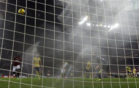 AC Milan's Kaka shoots to score against Lazio during their Italian Serie A soccer match at San Siro stadium in Milan