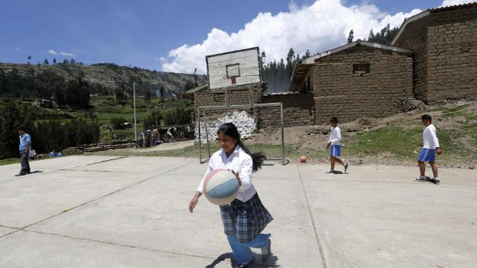 Students play basketball at a school in Pariaqaqa town in Ancash