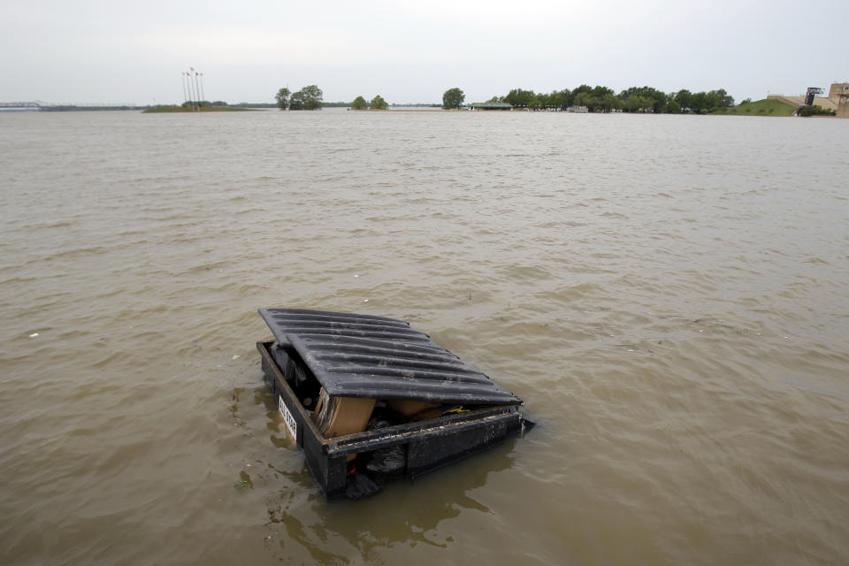 A garbage dumpster is seen surrounded by floodwater as Mud Island River Park is seen in the background Saturday, May 7, 2011, in Memphis, Tenn. Communities all along the banks of the Mississippi are keeping a close eye on the river's rise with the crest in Memphis not expected until Wednesday. (AP Photo/Jeff Roberson)