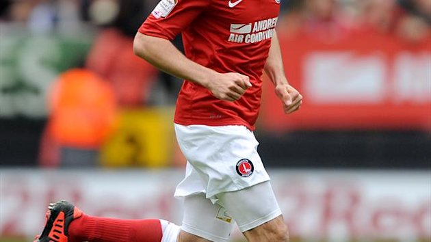 Danny Hollands will stay with Swindon for another month