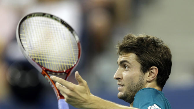 Gilles Simon, of France, reacts to a call during a match against Mardy Fish at the U.S. Open tennis tournament Saturday, Sept. 1, 2012 in New York. (AP Photo/Darron Cummings)
