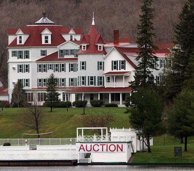 A large sign is seen in front of tyhe  Balsams Hotel Thursday, May 10, 2012 in Dixeville Notch, N.H. A preview is being held Thursday and Friday where an auction is set for Saturday to clear out the n