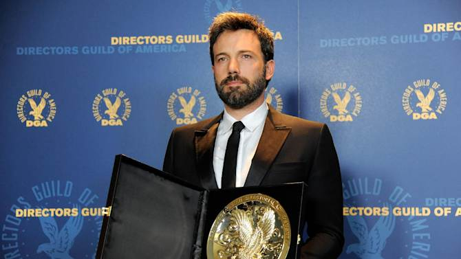"""Ben Affleck poses backstage with his award for outstanding directorial achievement in feature film for """"Argo"""" at the 65th Annual Directors Guild of America Awards at the Ray Dolby Ballroom on Saturday, Feb. 2, 2013, in Los Angeles. (Photo by Chris Pizzello/Invision/AP)"""