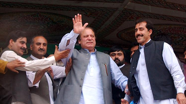Pakistan's former Prime Minister Nawaz Sharif waves to his supporters during an election rally in Jhagra near Peshawar, Pakistan on Tuesday, May 7, 2013. Pakistan is scheduled to hold parliamentary elections on May 11, the first transition between democratically elected governments in a country that has experienced three military coups and constant political instability since its creation in 1947. (AP Photo/Mohammad Sajjad)