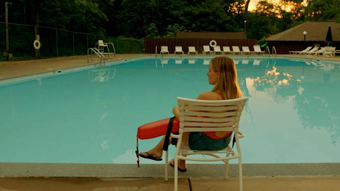 "This Nov. 23, 2012 publicity photo released by the Sundance Institute shows Kristen Bell in a scene from the film, ""The Lifeguard,"" by director, Liz Garcia, included in the U.S. Dramatic Competition at the 2013 Sundance Film Festival. The festival has 50-50 parity in directors, with eight women, eight men, among the 16 films in the competition, a record that female filmmakers consider a hopeful sign that they are making progress toward equal time with males. (AP Photo/Sundance Institute, John Peters)"