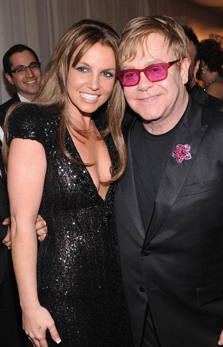 Spears attended the party with her manager Larry Rudolph and a friend. She was seen chatting with host Elton, who wore his trademark glasses and a sparkly flower pin on a black suit.  (Photo by Jamie McCarthy/Getty Images for EJAF)